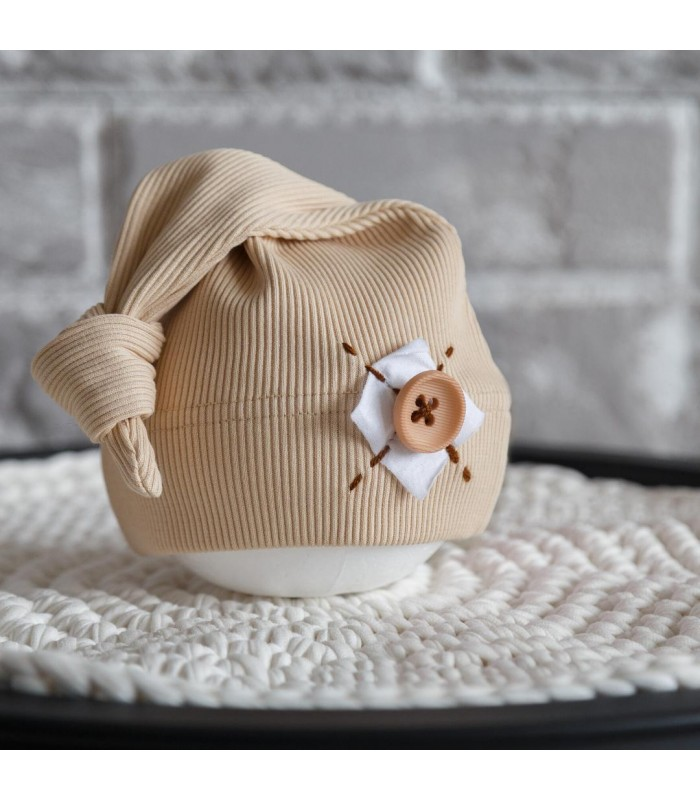 Шапочка для новорожденного ванильная